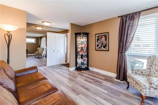 Photo 3: 915 Canna Crescent SW in Calgary: Canyon Meadows Detached for sale : MLS®# C4264269