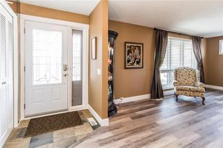 Photo 2: 915 Canna Crescent SW in Calgary: Canyon Meadows Detached for sale : MLS®# C4264269
