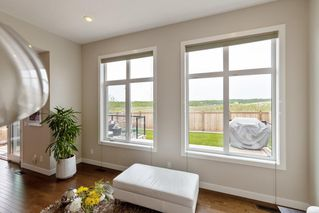 Photo 7: 204 ASCOT Crescent SW in Calgary: Aspen Woods Detached for sale : MLS®# A1025178