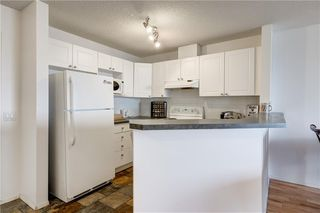 Photo 7: 1104 950 ARBOUR LAKE Road NW in Calgary: Arbour Lake Apartment for sale : MLS®# C4297455