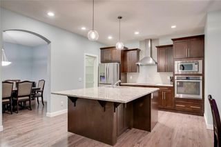 Photo 11: 117 Kinniburgh Way: Chestermere Detached for sale : MLS®# C4301536