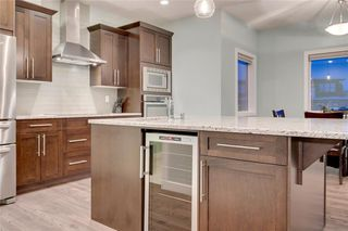Photo 10: 117 Kinniburgh Way: Chestermere Detached for sale : MLS®# C4301536