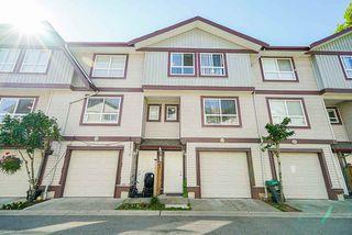 "Photo 1: 12 12730 66 Avenue in Surrey: West Newton Townhouse for sale in ""Simran Villas"" : MLS®# R2511431"