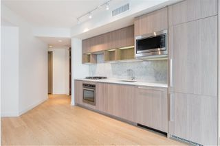 """Photo 1: 1720 68 SMITHE Street in Vancouver: Downtown VW Condo for sale in """"ONE PACIFIC"""" (Vancouver West)  : MLS®# R2401692"""