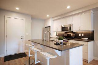 Photo 2: 9325 93 Street NW in Edmonton: Zone 18 House Triplex for sale : MLS®# E4202549