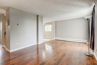 Photo 4: 201 312 CEDAR Crescent SW in Calgary: Spruce Cliff Apartment for sale : MLS®# A1057235