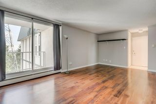 Photo 3: 201 312 CEDAR Crescent SW in Calgary: Spruce Cliff Apartment for sale : MLS®# A1057235