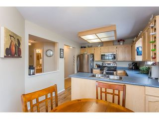 """Photo 5: 45 19649 53 Avenue in Langley: Langley City Townhouse for sale in """"Huntsfield Green"""" : MLS®# R2394879"""