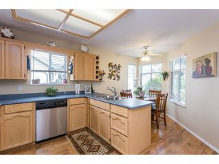 """Photo 3: 45 19649 53 Avenue in Langley: Langley City Townhouse for sale in """"Huntsfield Green"""" : MLS®# R2394879"""