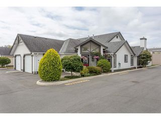 """Photo 1: 45 19649 53 Avenue in Langley: Langley City Townhouse for sale in """"Huntsfield Green"""" : MLS®# R2394879"""
