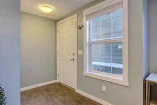 Photo 3: 34 AUBURN BAY Link SE in Calgary: Auburn Bay Row/Townhouse for sale : MLS®# A1027472