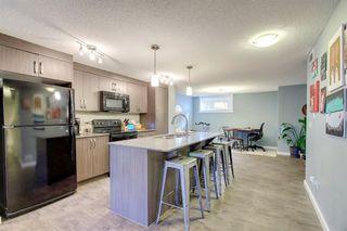 Photo 7: 34 AUBURN BAY Link SE in Calgary: Auburn Bay Row/Townhouse for sale : MLS®# A1027472