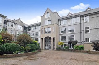 Photo 1: 308 20200 56 AVENUE in Langley: Langley City Condo for sale : MLS®# R2509709