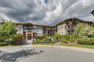 "Main Photo: 406 300 KLAHANIE Drive in Port Moody: Port Moody Centre Condo for sale in ""Tides"" : MLS®# R2418891"