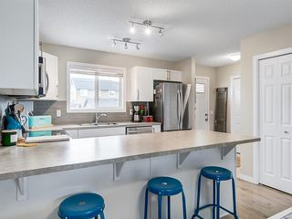 Photo 13: 142 Sunset Road: Cochrane Row/Townhouse for sale : MLS®# A1052095