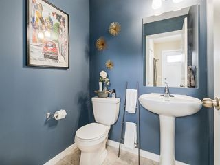Photo 15: 142 Sunset Road: Cochrane Row/Townhouse for sale : MLS®# A1052095