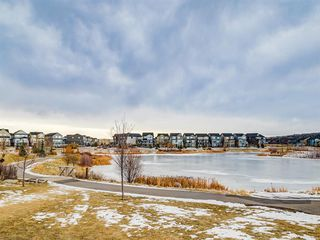 Photo 42: 142 Sunset Road: Cochrane Row/Townhouse for sale : MLS®# A1052095