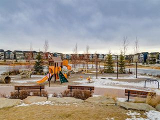 Photo 47: 142 Sunset Road: Cochrane Row/Townhouse for sale : MLS®# A1052095