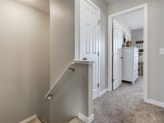 Photo 20: 142 Sunset Road: Cochrane Row/Townhouse for sale : MLS®# A1052095