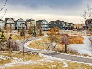 Photo 41: 142 Sunset Road: Cochrane Row/Townhouse for sale : MLS®# A1052095