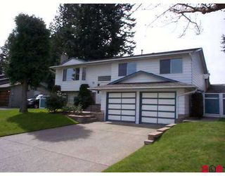 """Photo 1: 9665 151ST Street in Surrey: Guildford House for sale in """"GUILDFORD"""" (North Surrey)  : MLS®# F2708210"""