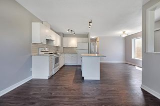 Photo 4: 1713 16 Street: Didsbury Semi Detached for sale : MLS®# A1009473
