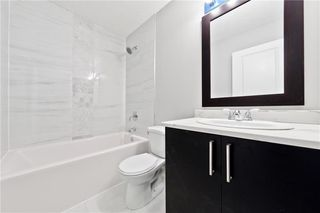 Photo 11: 100 DOVERVIEW Place SE in Calgary: Dover Detached for sale : MLS®# A1024220