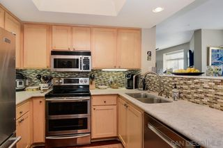 Photo 1: DOWNTOWN Condo for sale : 2 bedrooms : 2400 5th Ave #210 in San Diego