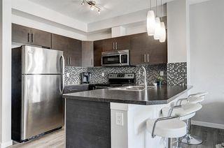 Photo 28: 413 207 SUNSET Drive: Cochrane Apartment for sale : MLS®# C4295535