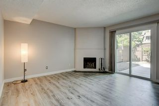 Photo 8: 34 6503 RANCHVIEW Drive NW in Calgary: Ranchlands Row/Townhouse for sale : MLS®# A1018661