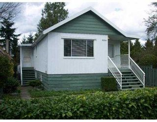 Photo 2: 2561 E 27TH Ave in Vancouver: Collingwood Vancouver East House for sale (Vancouver East)  : MLS®# V637679
