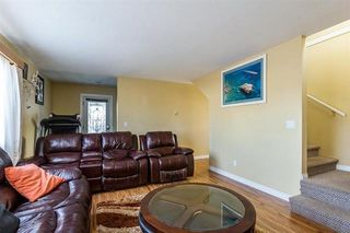 Photo 7: 12706 114A Avenue in Surrey: Bridgeview House for sale (North Surrey)  : MLS®# R2409317
