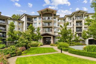Photo 1: 209 3050 DAYANEE SPRINGS Boulevard in Coquitlam: Westwood Plateau Condo for sale : MLS®# R2509975