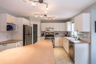 Photo 11: 81 Strathridge Close SW in Calgary: Strathcona Park Detached for sale : MLS®# A1051210