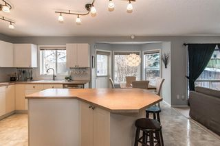 Photo 9: 81 Strathridge Close SW in Calgary: Strathcona Park Detached for sale : MLS®# A1051210