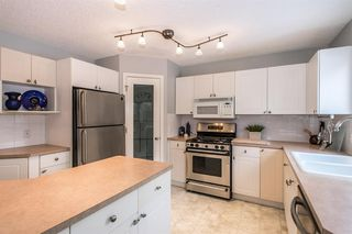 Photo 12: 81 Strathridge Close SW in Calgary: Strathcona Park Detached for sale : MLS®# A1051210
