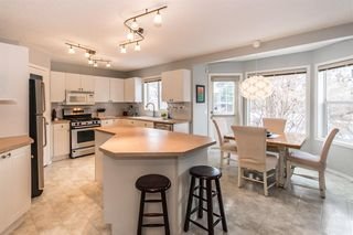 Photo 8: 81 Strathridge Close SW in Calgary: Strathcona Park Detached for sale : MLS®# A1051210