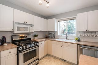 Photo 10: 81 Strathridge Close SW in Calgary: Strathcona Park Detached for sale : MLS®# A1051210