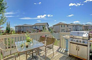 Photo 3: 78 Brightoncrest Grove SE in Calgary: New Brighton Semi Detached for sale : MLS®# A1032989
