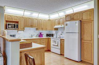 Photo 5: 127 8535 BONAVENTURE Drive SE in Calgary: Acadia Apartment for sale : MLS®# C4285053