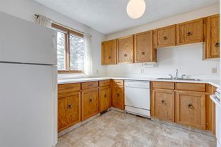 Photo 6: 100 23 Glamis Drive SW in Calgary: Glamorgan Row/Townhouse for sale : MLS®# A1056750