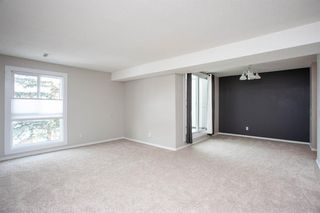 Photo 4: 1309 13104 Elbow Drive SW in Calgary: Canyon Meadows Row/Townhouse for sale : MLS®# A1056730