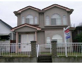 """Main Photo: 2418 E 33RD Ave in Vancouver: Collingwood Vancouver East House for sale in """"COLLINGWOOD"""" (Vancouver East)  : MLS®# V629753"""