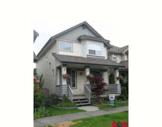 """Photo 1: 18461 67A Avenue in Surrey: Cloverdale BC House for sale in """"Heartland"""" (Cloverdale)  : MLS®# F2817207"""