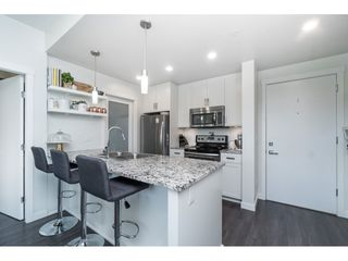 """Photo 7: 205 2242 WHATCOM Road in Abbotsford: Abbotsford East Condo for sale in """"WATERLEAF"""" : MLS®# R2455089"""