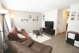 Photo 9: 109 107 Elm Place: Okotoks Row/Townhouse for sale : MLS®# A1056843