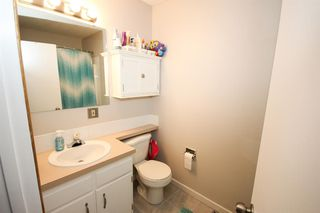 Photo 18: 109 107 Elm Place: Okotoks Row/Townhouse for sale : MLS®# A1056843