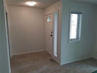 Photo 3: 531 55 Avenue SW in Calgary: Windsor Park Semi Detached for sale : MLS®# C4289517