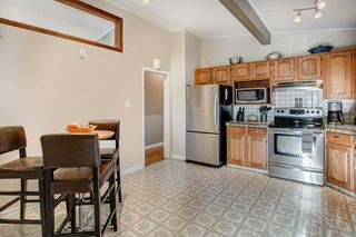Photo 10: 5735 LADBROOKE DR SW in Calgary: Lakeview House for sale : MLS®# C4273443