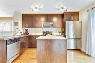 Photo 11: 101 ASPEN HILLS Drive SW in Calgary: Aspen Woods Row/Townhouse for sale : MLS®# A1009778
